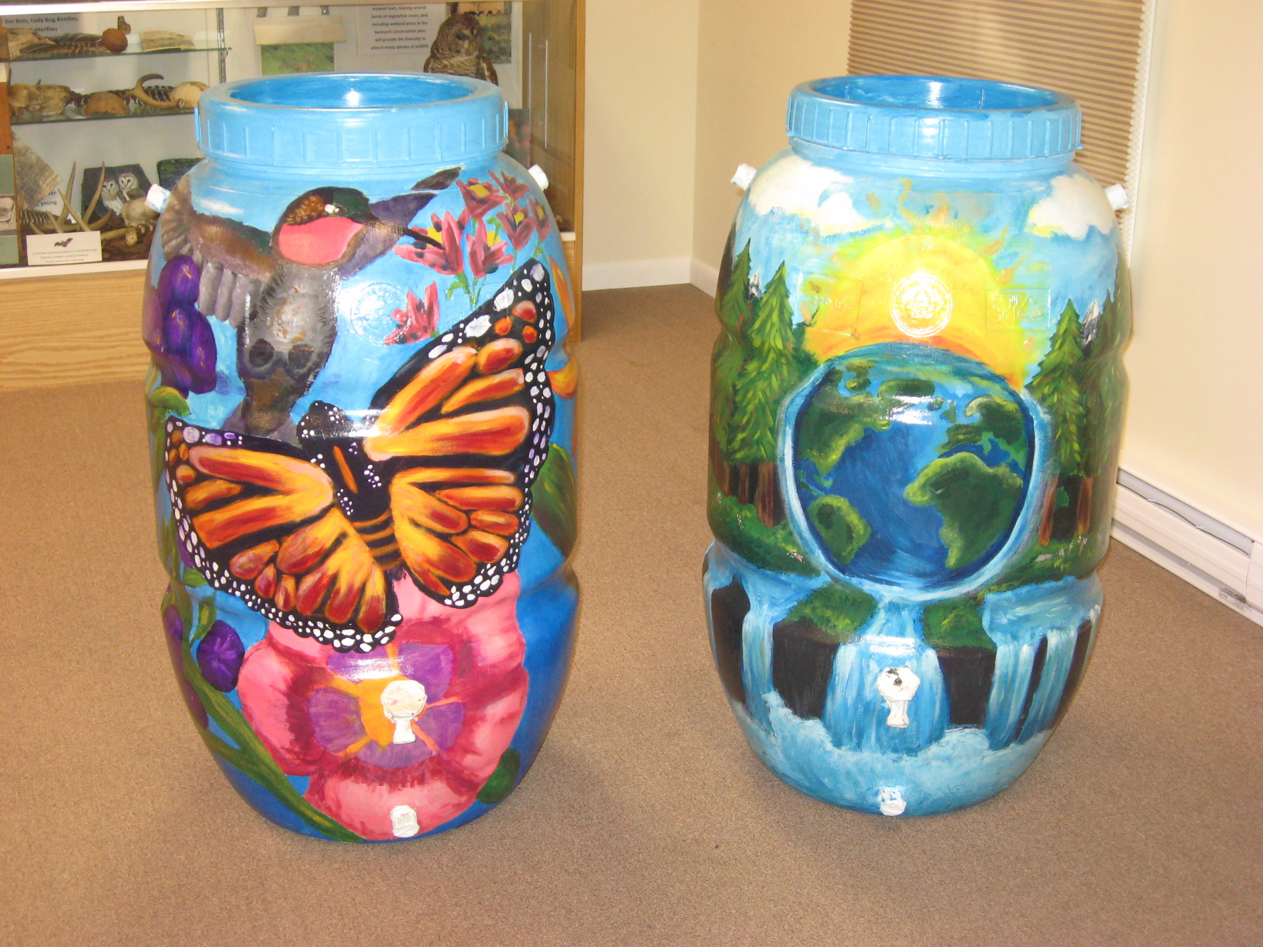 Two decoratively painted rain barrels made by the conservation district