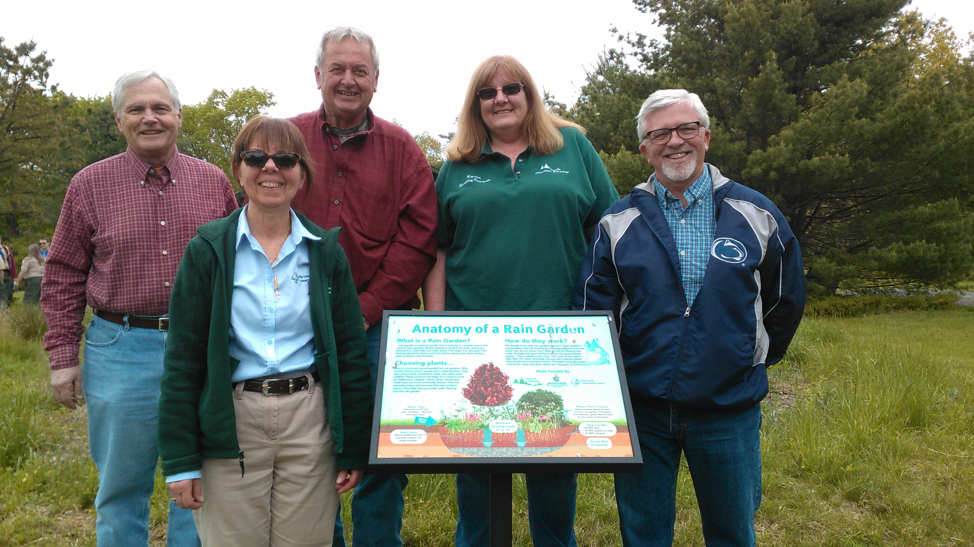 Photo of Pike County officials at the Bridge Preserve Celebration with a newly installed rain garden sign.