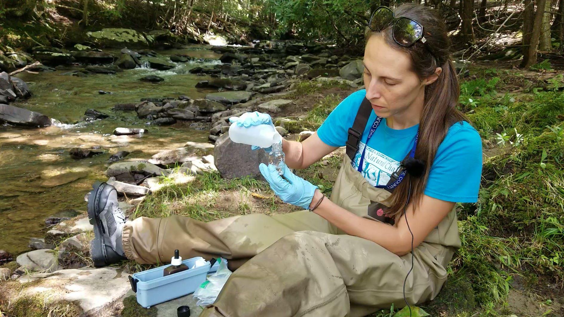 Rachel Posavetz testing the alkalinity of Kleinhans Creek.