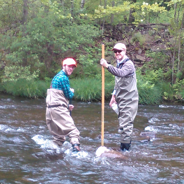 Photo of Matt Barr and Nick Spinelli conducting surface water monitoring.