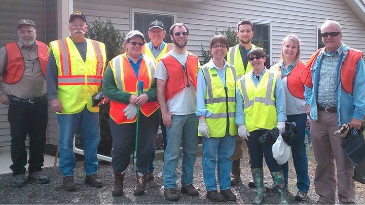 Picture of District staff, board members and volunteers after a road clean up on Route 402.